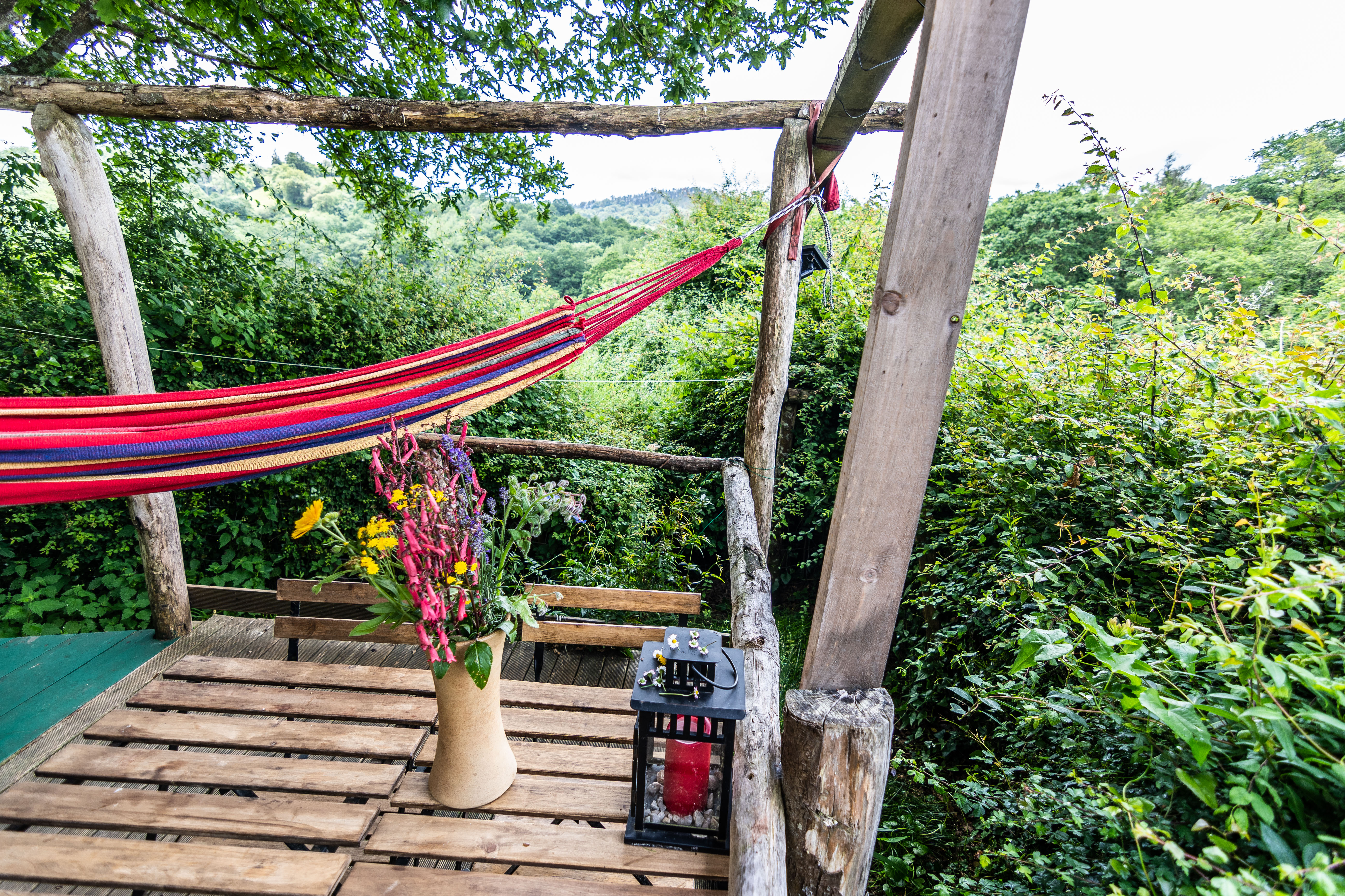 Views from caravan gardens with hammock and outdoor seating