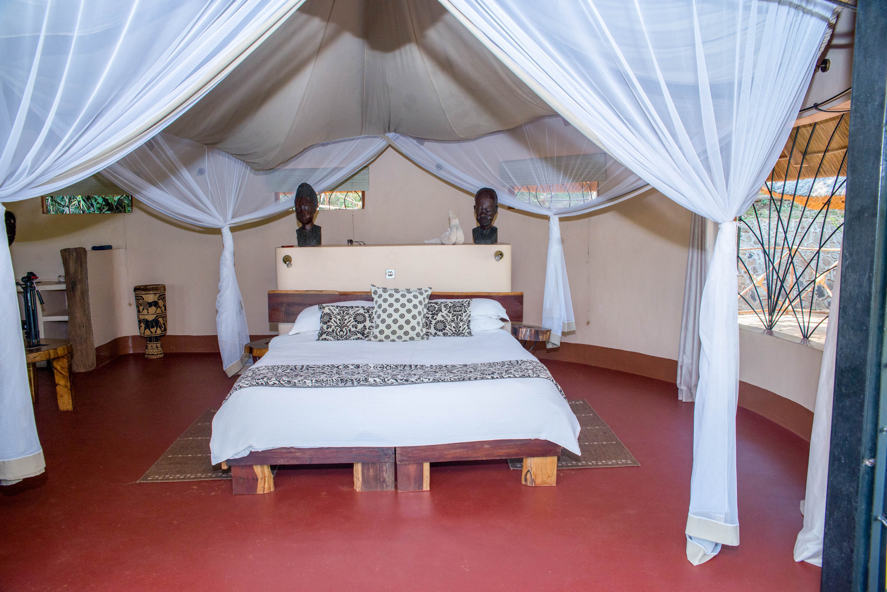 Bedroom with kingsize bed and mosquito nets